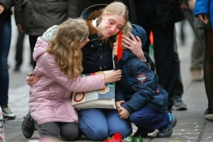 A woman consoles her children at a street memorial following Tuesday's bomb attacks in Brussels. (Reuters: Vincent Kessler)