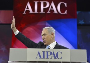 Israeli Prime Minister Benjamin Netanyahu acknowledges applause as he arrives to address the American Israel Public Affairs Committee (AIPAC), in Washington, March 4, 2014. Netanyahu urged world powers on Tuesday not to allow Iran to retain the ability to enrich uranium, saying it must be stripped of all nuclear technologies with bomb-making potential. REUTERS/Mike Theiler (UNITED STATES - Tags: POLITICS TPX IMAGES OF THE DAY) - RTR3G15H