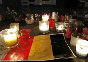 Candles are pictured around a Belgian flag on the Place de la Republique in Paris. (photo credit:REUTERS)