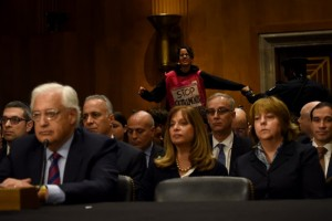 A demonstrator interrupts David Friedman, the nominee to be U.S. ambassador to Israel, as he spoke before the Senate last month. (Michael Robinson Chavez/The Washington Post)